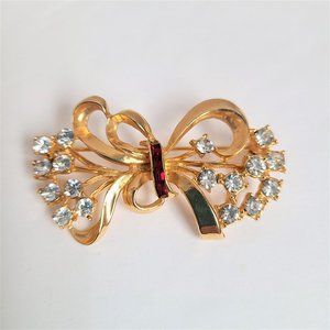 Gold tone bow brooch with rhinestones.